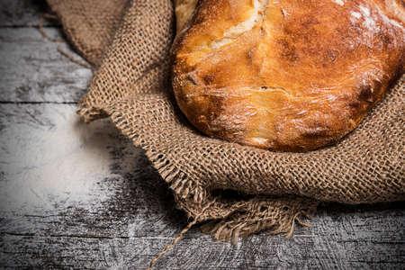 Rustic bread Rustic bread  on the old board