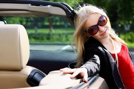 charming blonde and the car photo
