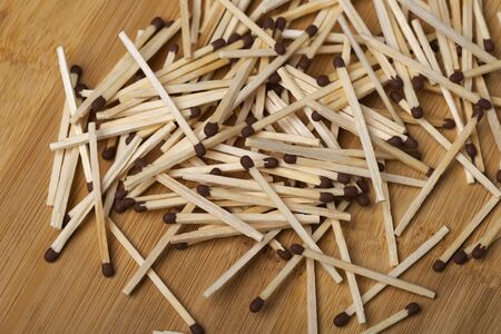 Matches on a white isolated background. Matches on a wooden background. Matches.