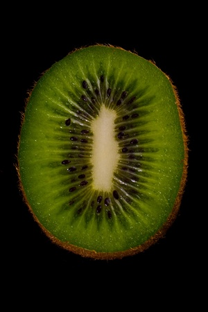 Sliced kiwi fruit isolated on a black background. Stock Photo