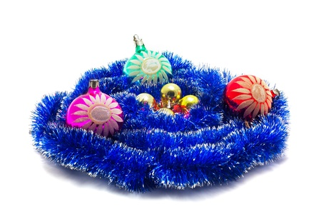 Christmas still life of toy and streamers isolated on white.