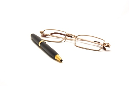 Pen and eyeglasses isolated on white.