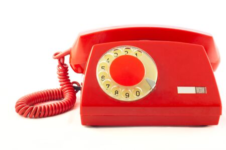 Old red plastic phone on a white background. Stock Photo - 11784046