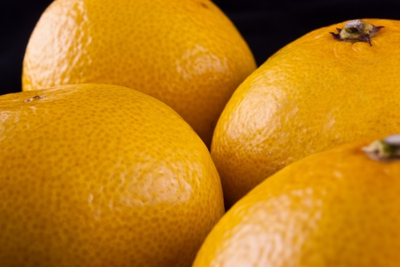 Juicy tangerines on a black background. Stock Photo