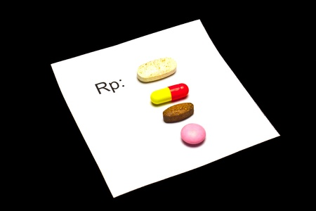 The tablets are on the prescription form  Stock Photo
