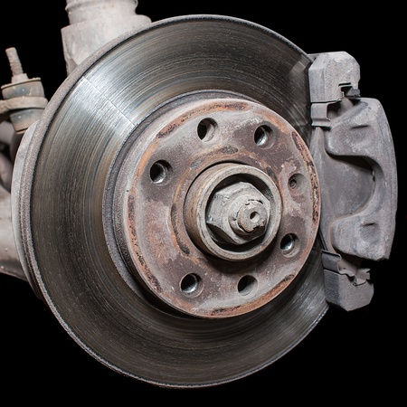 The former used a little rusty brake disc  photo