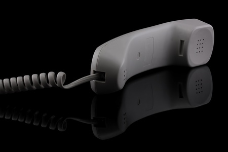 White handset isolated on a black background