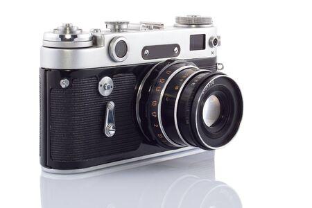 The old rangefinder camera isolated on white background