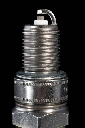 One spark plug on a black background  The small depth of field Stock Photo - 13894396