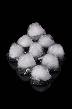 Nine ice cubes isolated on a black background