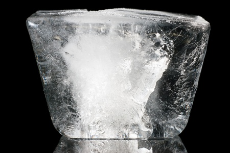 One ice cube isolated on a black background  Stock Photo