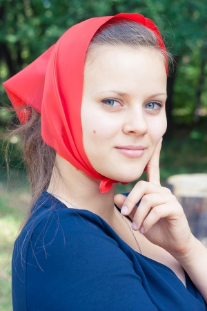 Portrait of pretty young girls outdoors  A girl in a red kerchief Stock Photo - 15134894