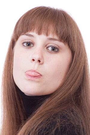 Girl on a white background showing his tongue