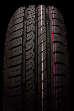 Car tire isolated on a black background Stock Photo - 16398911