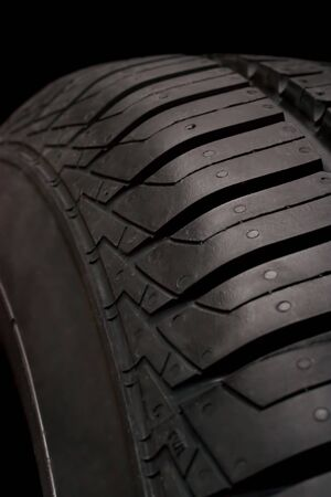 Car tire isolated on a black background  Stock Photo - 16398951