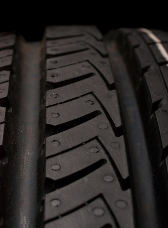 Car tire isolated on a black background Stock Photo - 16398913