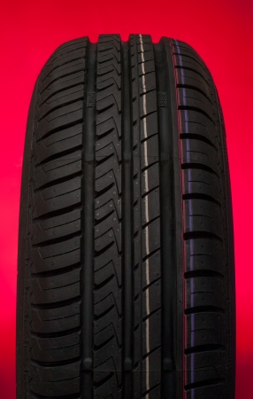 Car tire isolated on a red background Stock Photo - 16399001