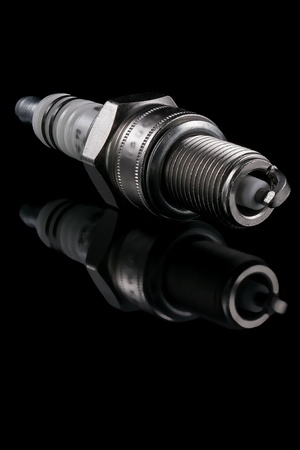 One spark plug on a black background