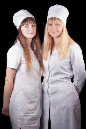 Two nurses in uniform on a black background Stock Photo - 16622414