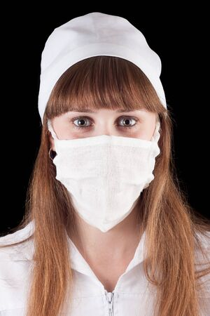 Nurse in uniform and mask on a black background Stock Photo - 16622433