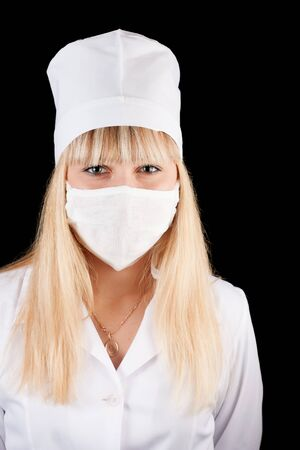 Nurse in uniform and mask on a black background Stock Photo - 16622040