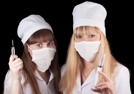 Two nurses in uniform on a black background Stock Photo - 16757983