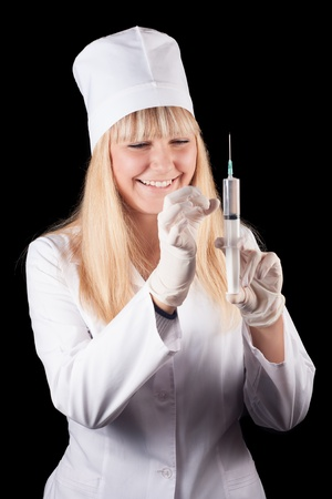 Nurse hold syringe in hand on a black background  photo
