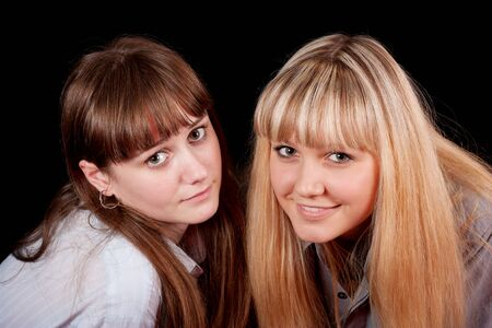 Two young girls on a black background  photo