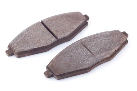 oxidate: Old rusty used car brake pads on a white background