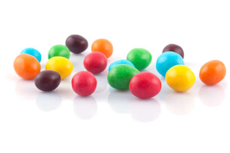 Multicolored round candies on a white background