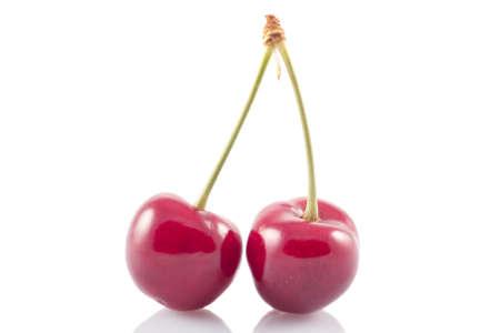 Tasty ripe cherry on a white background