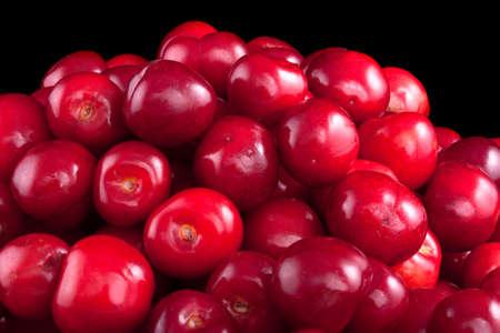 Tasty ripe cherry on a black background