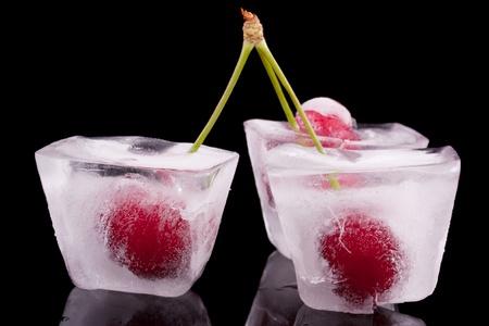 Berries frozen cherry in the ice  Stock Photo