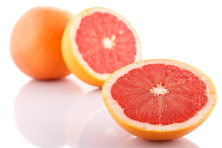Half of fresh grapefruit on white background