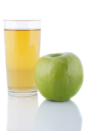 A glass of fresh apple juice next to the apple  Stock Photo