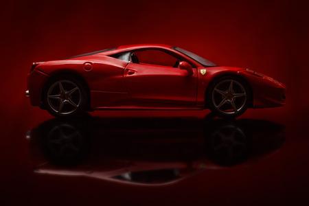 KRIVOY ROG, UKRAINE - AUG 22- Toy ferrari 458 Italia on red background, Friday 22 August 2014 Editorial