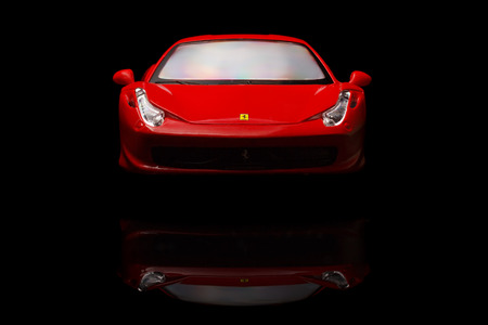 KRIVOY ROG, UKRAINE - AUG 22- Toy ferrari 458 Italia on black background, Friday 22 August 2014