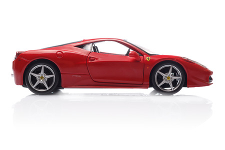 KRIVOY ROG, UKRAINE - AUG 22- Toy ferrari 458 Italia on white background, Friday 22 August 2014 Редакционное