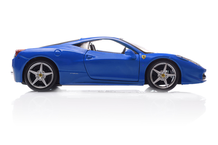 KRIVOY ROG, UKRAINE - AUG 22- Toy ferrari 458 Italia on white background, Friday 22 August 2014