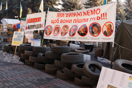 outcry: KRIVOY ROG, UKRAINE - DEC 13 - People demand the resignation of the government of Krivoy Rog, living in tents in front of the city administration, Saturday 13 December 2014