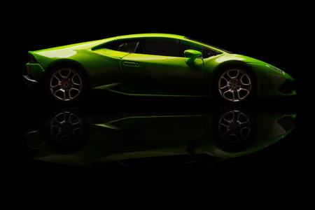 SANTAGATA BOLOGNESE, BOLOGNA, ITALY - JAN 20 - Toy lamborghini huracan on black background, Tuesday 20 January 2015
