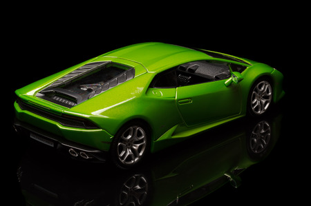 lamborghini: SANTAGATA BOLOGNESE, BOLOGNA, ITALY - JAN 20 - Toy lamborghini huracan on black background, Tuesday 20 January 2015