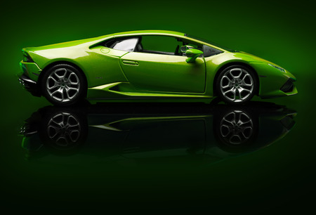 lamborghini: SANTAGATA BOLOGNESE, BOLOGNA, ITALY - JAN 20 - Toy lamborghini huracan on green background, Tuesday 20 January 2015