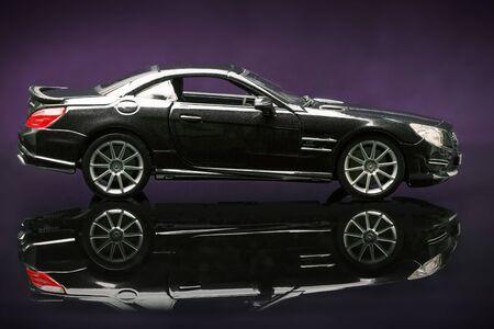 daimler: Stuttgart, Germany - APR 04- Mercedes SL 65 AMG on purple background, Saturday 04 April 2015