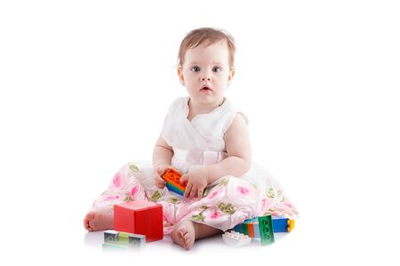 female clothing: The girl is one year in dress sitting on a white background.