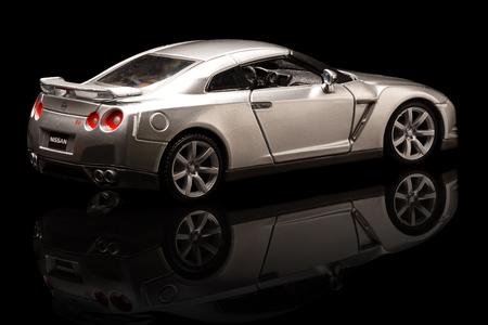 egoist: YOKOHAMA JAPAN APR 04 Toy Nissan GTR on background Saturday 04 April 2015