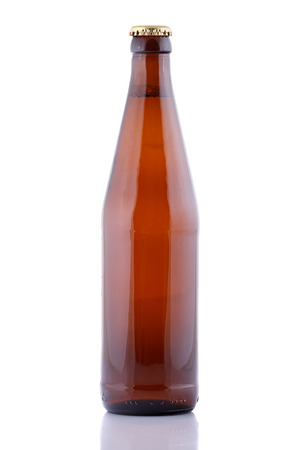 single beer bottle: Closed brown beer bottle on a white background. Stock Photo