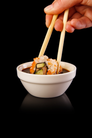 Roll the delicious sushi on a background. Stock Photo