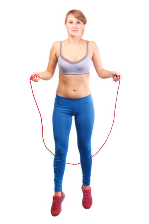 Girl jumping rope on a white background.
