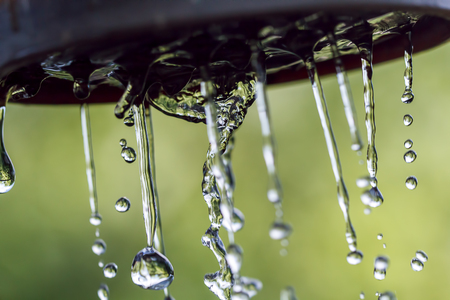 Raindrops on a rope for clothes on a blurred background.